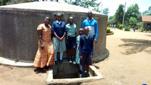 The Water Project:  Field Officer Betty Majani Poses With Students At The Tank