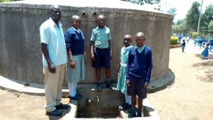 The Water Project:  Headteacher Simon Khalumi And Students At The Tank