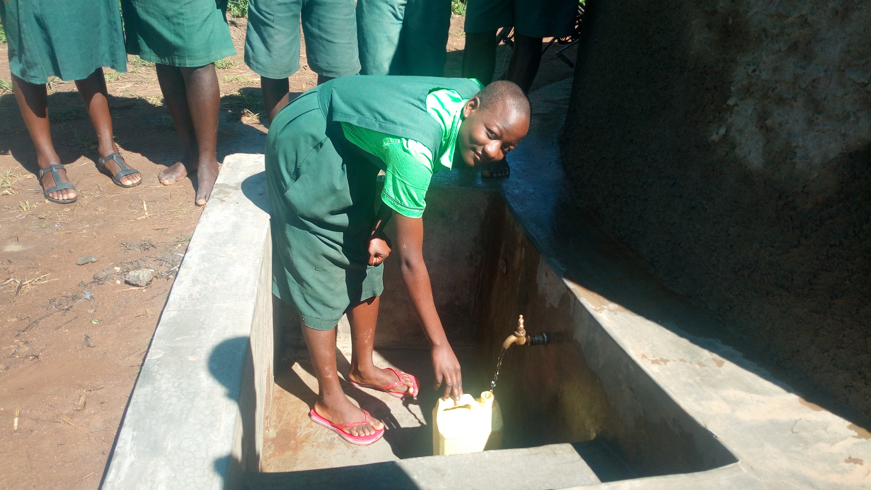The Water Project : kenya4692-student-fetches-water-at-the-tank