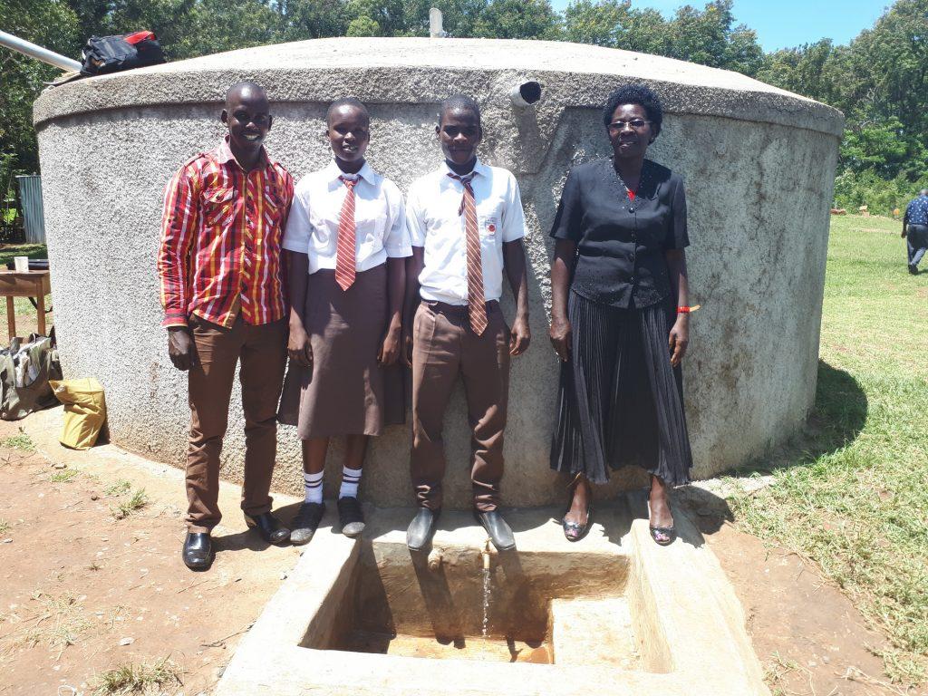 The Water Project : kenya4693-field-officer-jonathan-mutai-joshua-wambire-and-principal-joyce-kisali