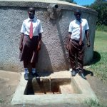 The Water Project: Shiyabo Secondary School -  Joshua Wambire And One Of His Classmates At The Tank