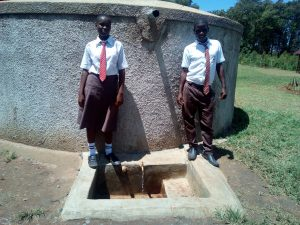 The Water Project:  Joshua Wambire And One Of His Classmates At The Tank