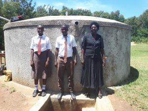 The Water Project:  Joshua Wambire With Principal Joyce Kisali
