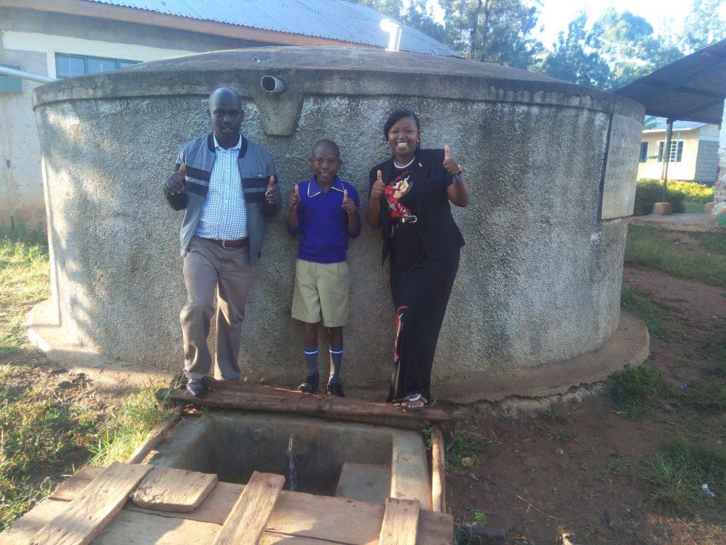 The Water Project : kenya4694-headteacher-christopher-birgen-zebedee-alubitsia-and-field-officer-jacklyne-chelagat