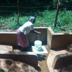 The Water Project: Irenji Community, Shianda Spring -  Ruth Ayoli Enjoys Water At The Spring
