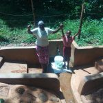 The Water Project: Irenji Community, Shianda Spring -  Ruth Ayoli With Bravin Mumala At The Spring