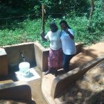 The Water Project: Irenji Community, Shianda Spring -  Ruth Ayoyi And Field Officer Jacklyne Chelagat