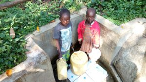 The Water Project:  Brian Murunga And His Sister Fetch Water