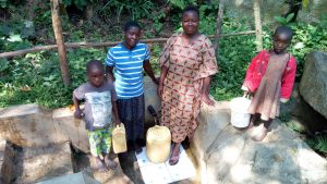 The Water Project:  Brian Murunga His Mother Phanice Nashilove And His Sister At The Spring