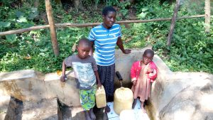 The Water Project:  Brian Murunga His Mother And His Sister At The Spring