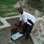 The Water Project: Futsi Fuvili Community A -  A Man Collects Water From The Spring