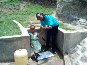 The Water Project:  A Young Girl And Field Officer Joan Were At The Spring