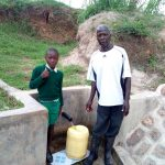 The Water Project: Futsi Fuvili Community, Shikanga Spring -  Jacob Askari Poses At The Spring