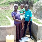 The Water Project: Futsi Fuvili Community, Shikanga Spring -  Rebecca Askari Her Daughter And Field Officer Joan Were