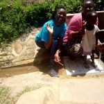 The Water Project: Kakubudu Community -  Field Officer Olivia Bomji Agripinna Livivi And Ashely Lukatsiva