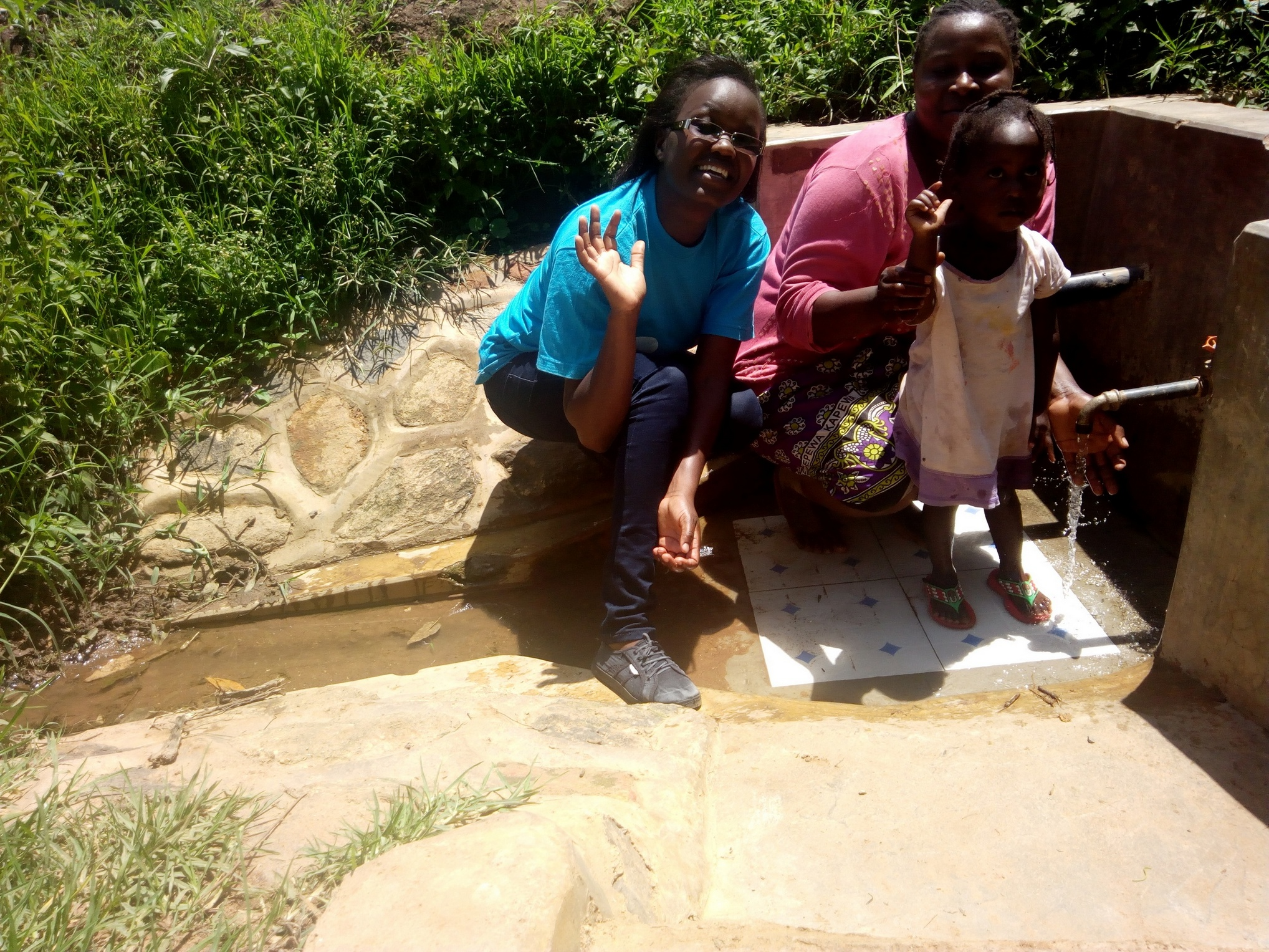 The Water Project : kenya4749-field-officer-olivia-bomji-agripinna-livivi-and-ashely-lukatsiva