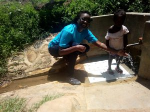 The Water Project:  Field Officer Olivia Bomji And Ashely Lukatsiva