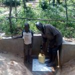 The Water Project: Mkunzulu Community, Museywa Spring -  Shadrack Mwochi With Clarence Askanga