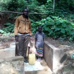 The Water Project: Elunyu Community -  Field Officer Wilson Kipchoge And Maximila Nekesa