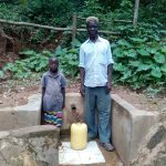 The Water Project: Elunyu Community, Saina Spring -  Herman Kaongeli With Maximila Nekesa