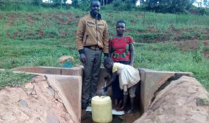The Water Project:  Field Officer Wilson Kipchoge With Irene Munyasa And Rebecca Asiko