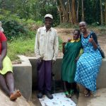 The Water Project: Shikoti Community, Amboka Spring -  Bassiliano Amboka Bridgit Shiundu And Field Officer Joan Were