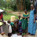 The Water Project: Shikoti Community, Amboka Spring -  Bridgit Shiundu Her Family And Field Officer Joan Were