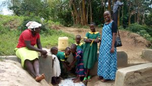 The Water Project:  Bridgit Shiundu Her Family And Field Officer Joan Were