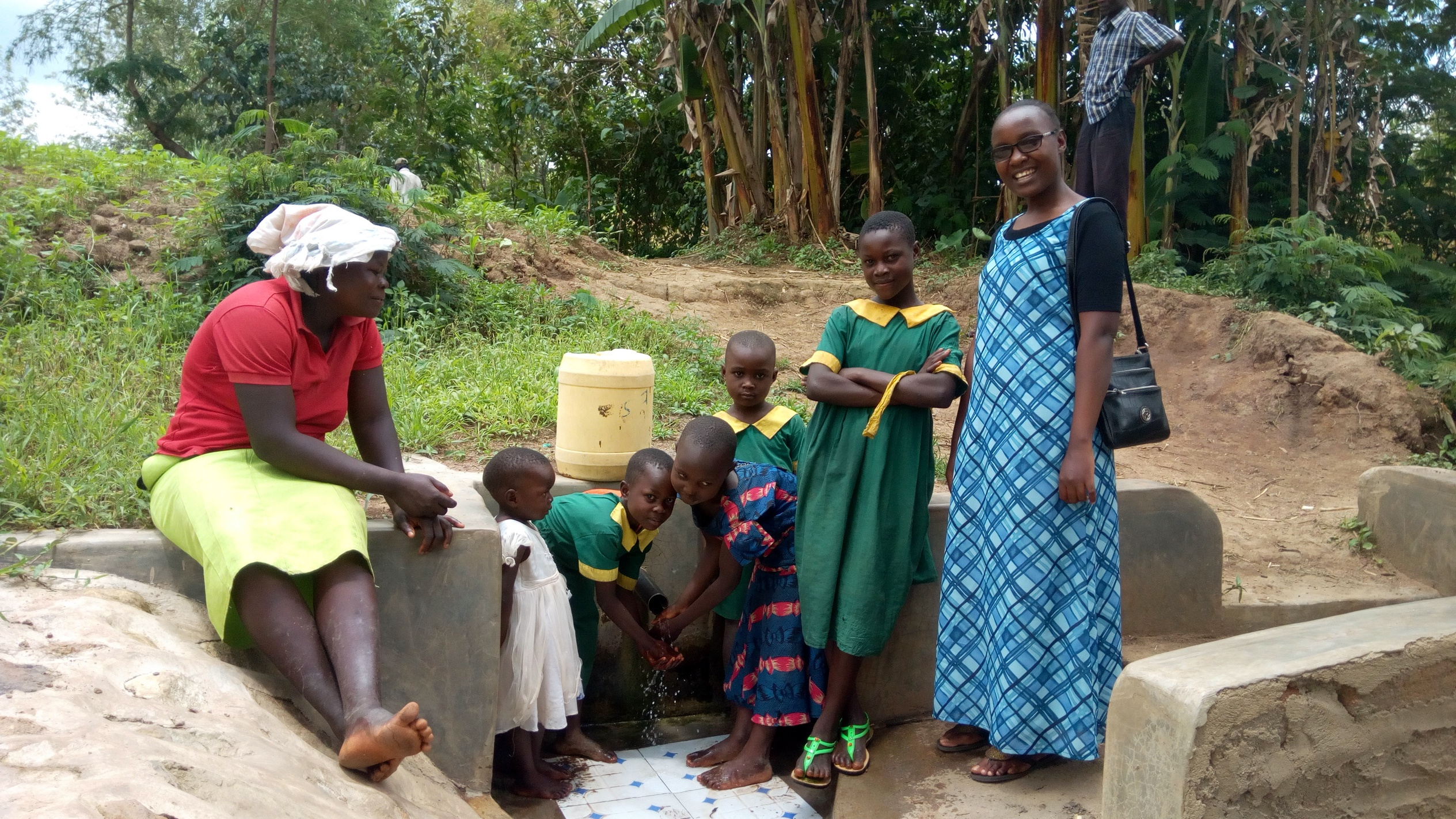 The Water Project : kenya4754-bridgit-shiundu-her-family-and-field-officer-joan-were