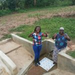 The Water Project: Mulundu Community -  Field Officer Faith Muthama And Rose Atira
