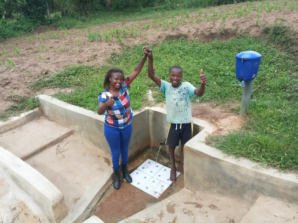 The Water Project : kenya4755-field-officer-faith-muthama-and-bonface-ouko