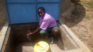The Water Project:  A Student Fetches Water At The Tank