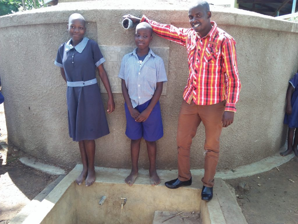 The Water Project : kenya4839-lvenda-adeya-and-owen-wanaami-with-field-officer-jonathan-mutai