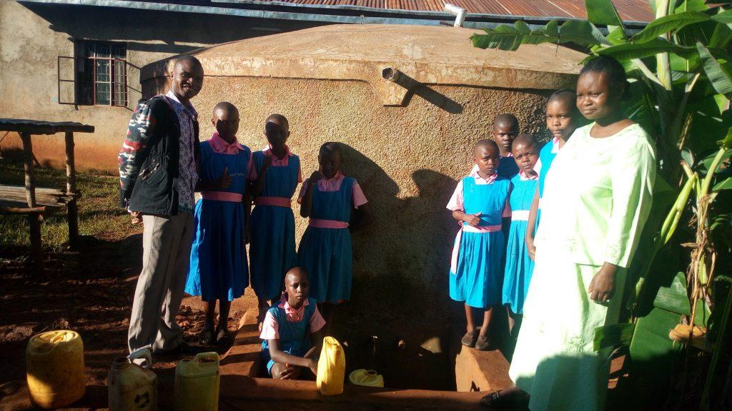 The Water Project : kenya4840-robert-amiani-and-students-at-the-tank