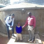 The Water Project: Gidagadi Primary School -  Field Officer Samuel Simdi Emmanuel Mbali And Teddy Liabeha