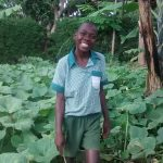 The Water Project: Ebusiratsi Special Primary School -  Dan Standing At A Pumpkin Plantation At The School