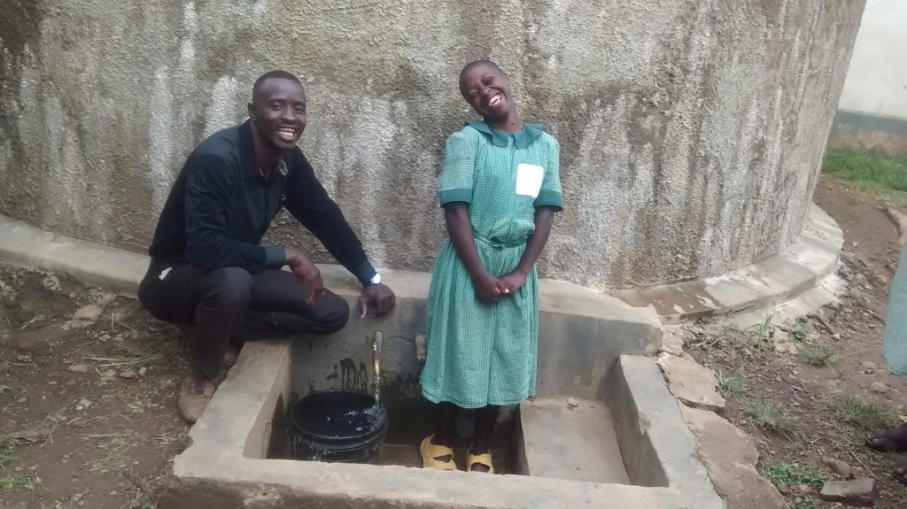 The Water Project : kenya4843-field-officer-erick-wagaka-and-lilian-migale