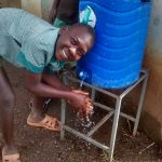 The Water Project: Ebusiratsi Special Primary School -  Student Uses The Handwashing Station