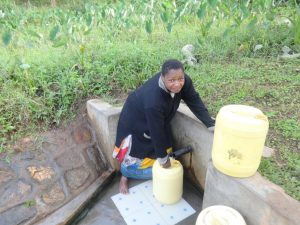 The Water Project:  Josephine Mmbone Fetches Water From The Spring