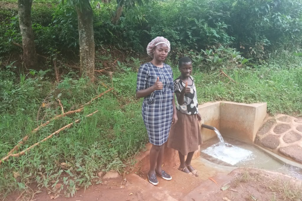 The Water Project : kenya4855-field-officer-faith-muthama-and-mitchell-lumbasi