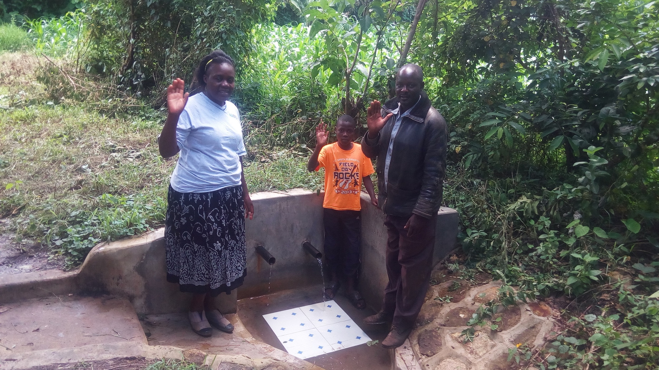 The Water Project : kenya4856-field-officer-karen-maruti-simon-kombwa-and-kefa-kombwa