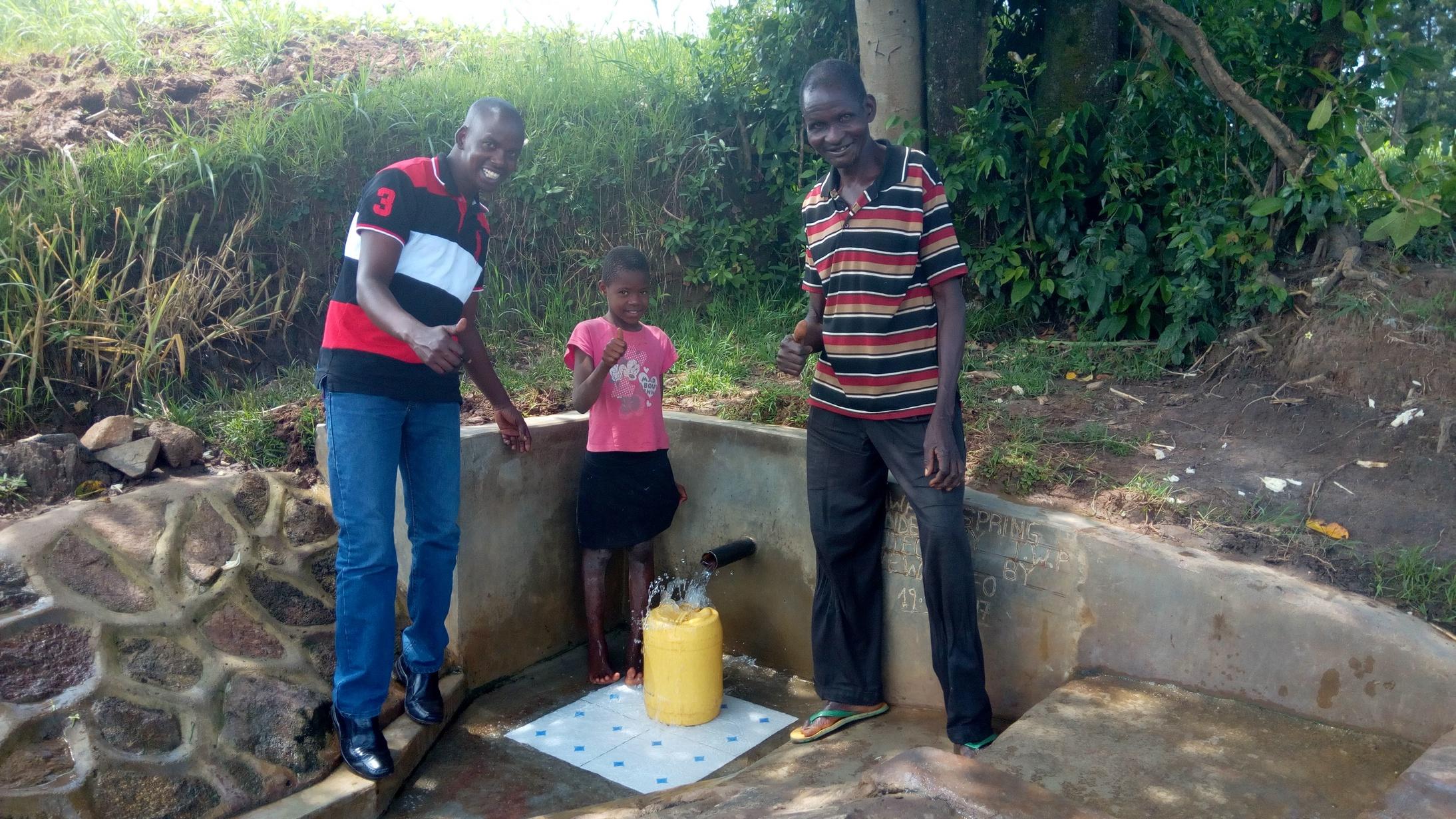 The Water Project : kenya4857-field-officer-jonathan-mutai-mercy-simwa-and-simion-simwa
