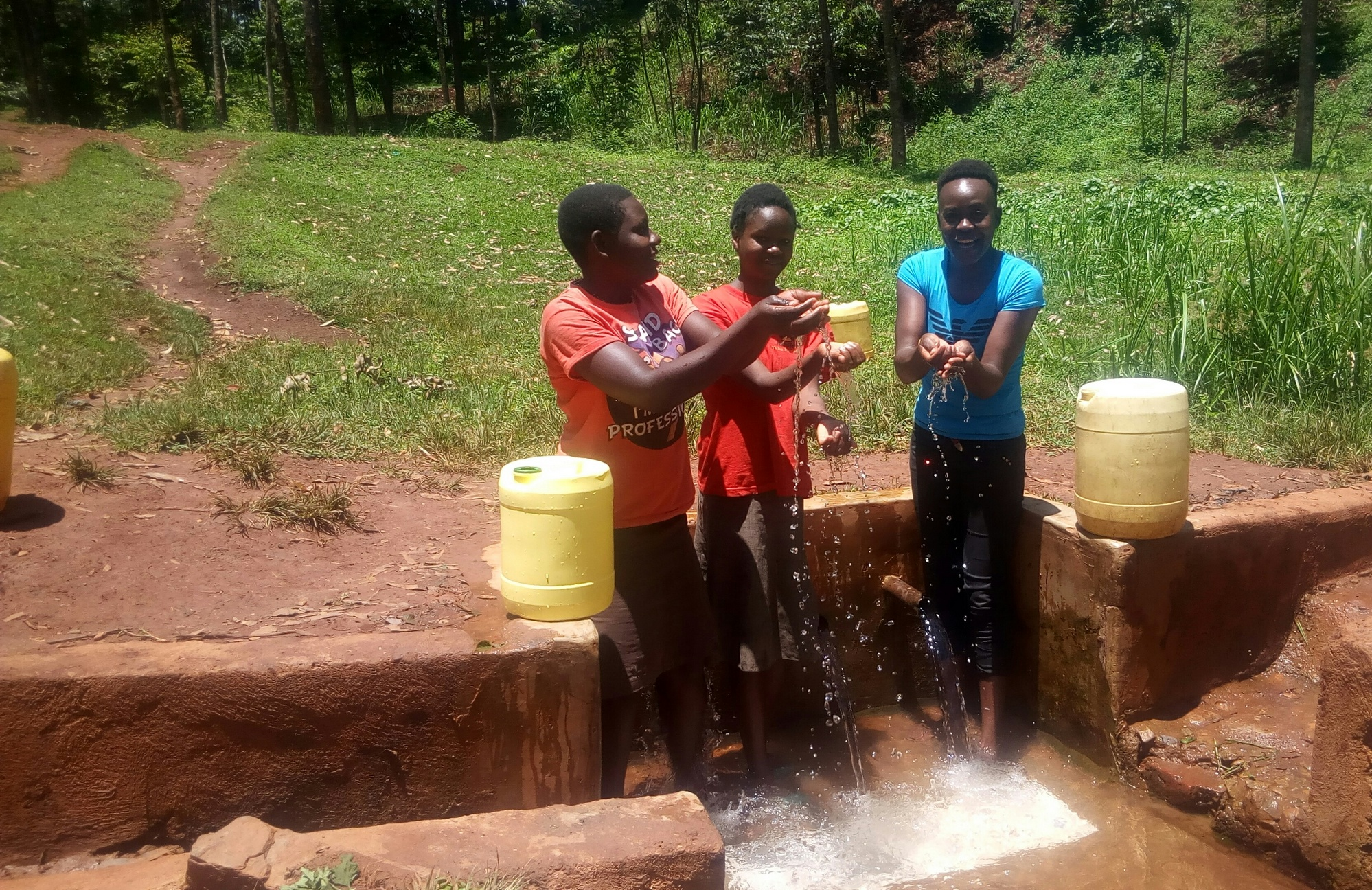 The Water Project : kenya4858-catherine-egehiza-beverlyne-akadanya-and-field-officer-lillian-achieng