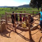 The Water Project: Rubani-Kyawalayi Community -  Community Members Using The Water Point
