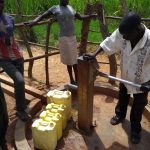 The Water Project: Rwentale-Kyamugenyi Community -  Community Members Using The Water Point