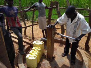 The Water Project:  Community Members Using The Water Point