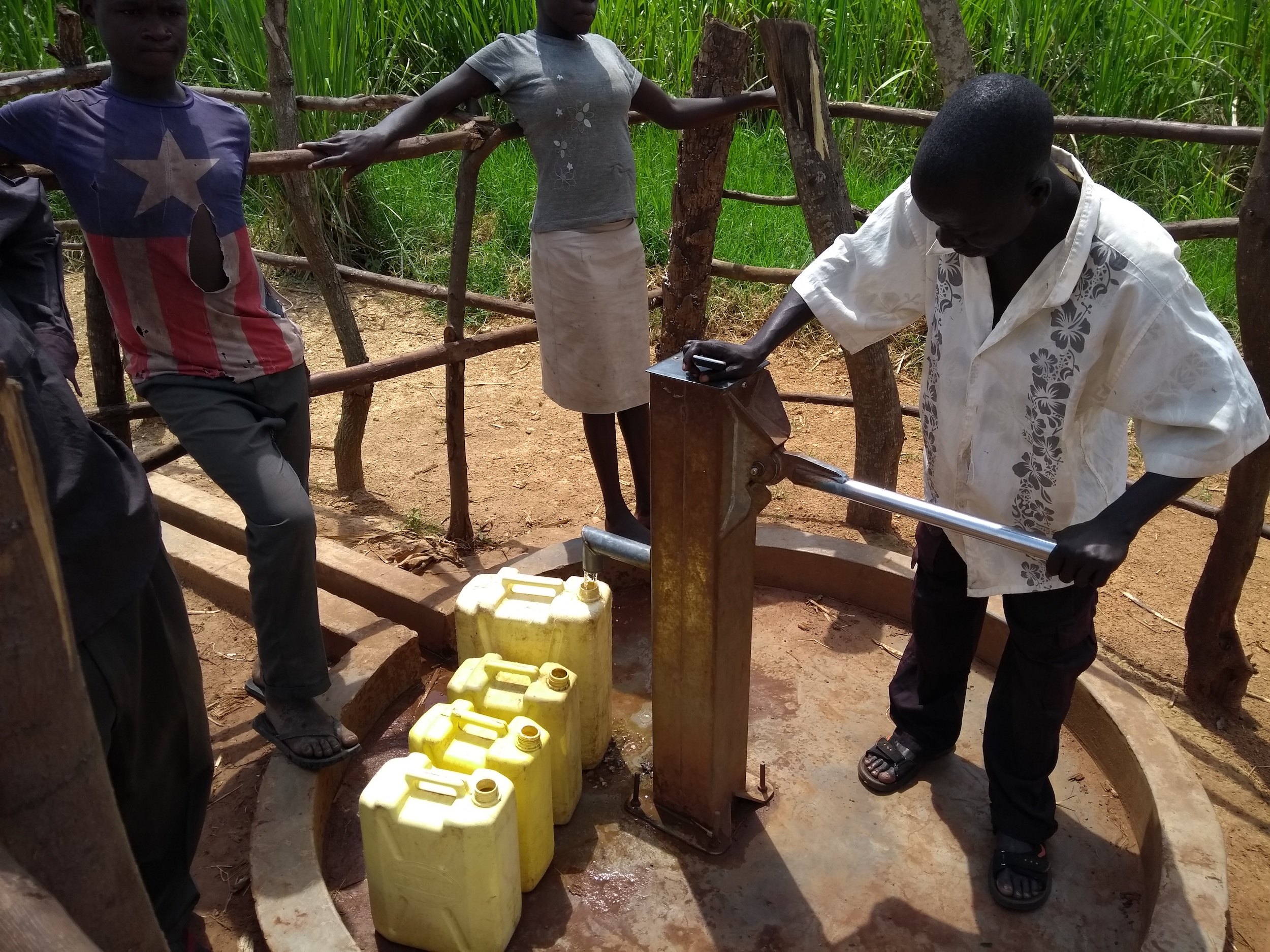 The Water Project : uganda6080-community-members-using-the-water-point