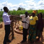 The Water Project: Rwentale-Kyamugenyi Community -  Field Staff Having A Conversation With Community Members