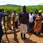 The Water Project: Rwentale-Kyamugenyi Community -  Community Members Happy About Their Water Point
