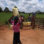 The Water Project: Byebega-Kirisa Community -  Community Members Using The Water Point